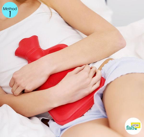 पीरियड्स में पेट में ऐंठन होने पर हीटिंग पैड का उपयोग कीजिये